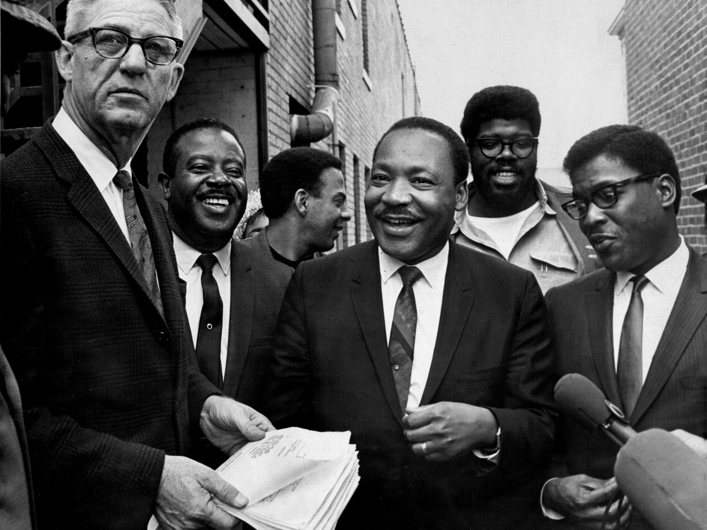 Outside the Lorraine Motel Wednesday, April 3, 1968, U.S. Marshal Cato Ellis served Dr. Martin Luther King Jr. with a temporary restraining order from a federal judge, barring them from leading another march in Memphis without court approval.