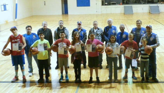 Knights of Columbus Free Throw volunteers and champions, from left (front row); Alexander Kyle, nine-years-old; Mikey Rose 10-years-old; Ilyanna Egans, 10-years-old; Bianca Artiaga ,11-years-old; Leia Kyle, 12-years-old; Owen Herrera, 12-years-old; Xavier Otero, 13-years-old; and Seth Temple, 14-years-old.