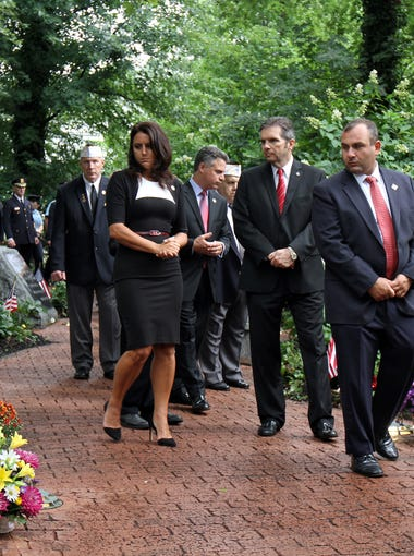 Middletown Mayor Stephanie Murray and members of the township committee lead a silent walk through the WTC Memorial Gardens in Middletown, NJ during a silent ceremony to honor the 37 Middletown residents who lost their lives on 9/11 Friday September 11, 2015.