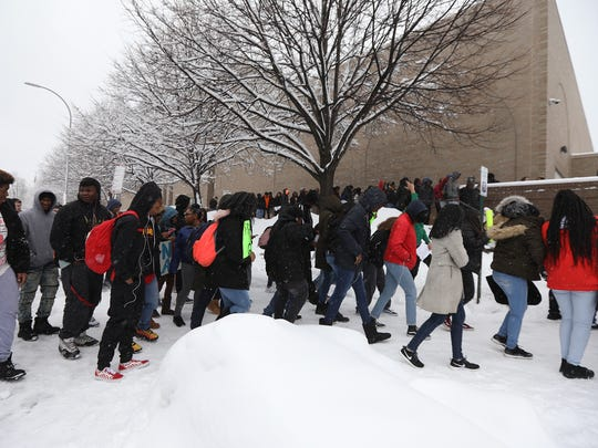 Several hundred students at School of the Arts walked