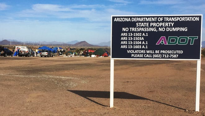 """Arizona Department of Transportation officials recently erected a """"No trespassing"""" sign near a veterans homeless camp adjacent to the Loop 202 freeway in Mesa. ADOT later said it has no plans to evict the camp."""