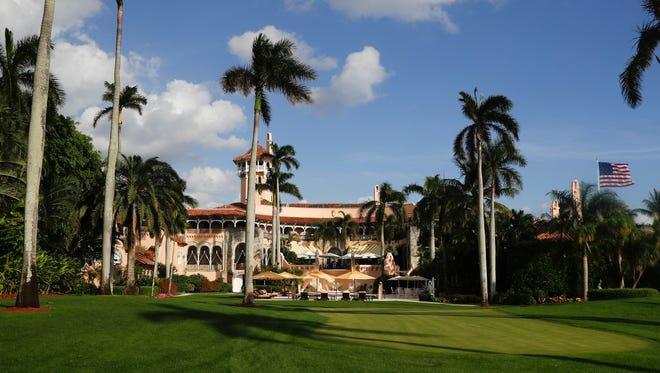 In this Nov. 27, 2016, file photo, Mar-a-Lago is seen from the media van window in Palm Beach.
