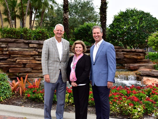 At left, Budge Huskey, President of Premier Sotheby's International Realty, stands with Judy Green, the CEO of Premier Sotheby's, and Brian Stock, with Stock Realty.