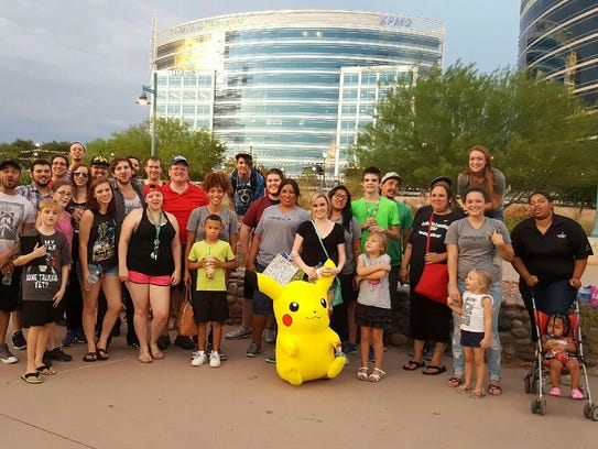 A group of people joined Ty Swartout for a Pokemon-hunting