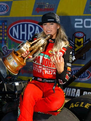 Leah Pritchett celebrates after winning the Top Fuel category at the NHRA SpringNationals at Royal Purple Raceway.