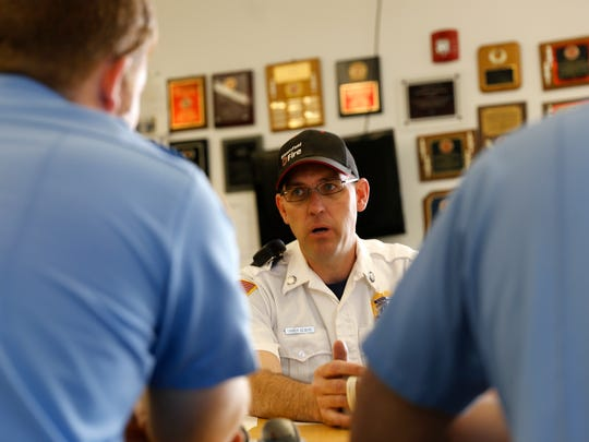 Capt. Travis Olbert, center, talks with firefighters Ryan Varnell, left, and Tony Herrera during a safety meeting Friday at the Bloomfield Fire Department.