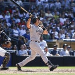 Mark Teixeira drives a home run down the right field against the San Diego Padres in the eighth inning on Sunday, July 3, 2016, in San Diego. It was Teixeira's 400th career home run.