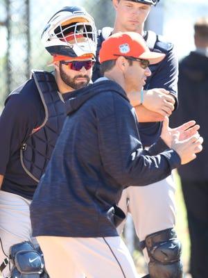 Detroit Tigers catcher Alex Avila, left, listens to manager Brad Ausmus during spring training Friday, Feb. 17, 2017, in Lakeland, Fla.
