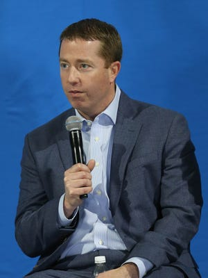 Detroit Lions general manager Bob Quinn talks to fans before the new uniforms were unveiled at Ford Field on Thursday, April 13, 2017.