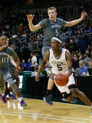 Thomas Kithier, 5, was declared ineligible after he transferred to Clarkston.  Kimberly P. Mitchell/detroit free press U-D Jesuit's Cassius Winston (5) dribbles past Macomb Dakota's Thomas Kithier during an MHSAA boys basketball Class A semifinal Friday, March 25, 2016, at the Breslin Center in East Lansing. U-D won, 72-51.