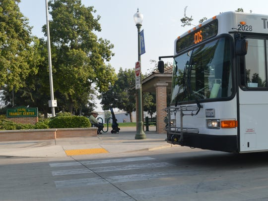 The route 11X bus leaves the Tulare Transit Center.