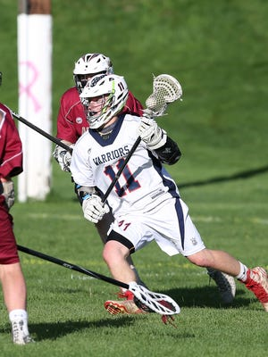 Wappingers' James Pratt (11)  drives to the goal against Arlington during boys lacrosse action at Wappingers Junior High School May 2, 2017. Wappingers won the game 12-7.