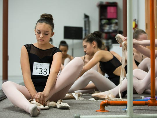 "Thirteen-year-old Miranda Romero, left, and others change their ballet shoes out for point shoes on Saturday, September 24, 2016, during an audition held at the Las Cruces School of Dance and Music for the Moscow Ballet's ""Great Russian Nutcracker"" to be performed in El Paso, TX December 23, 2016."