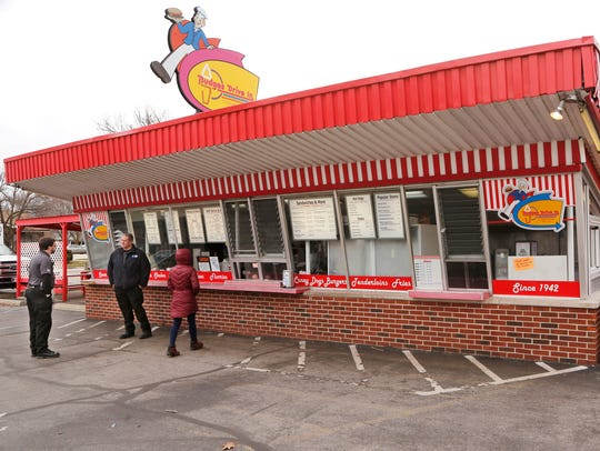 A steady stream of customers arrive to place orders during the the noon hour Monday at Budges Drive In, 1102 N. 14th Street in Lafayette. The popular walk up restaurant on Lafayette's north end opened March 1.
