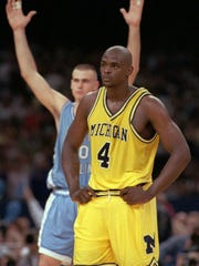 FILE - In this April 5, 1993, file photo, Michigan's Chris Webber (4) stands by as North Carolina's Eric Montross celebrates during North Carolina's technical foul shots in the final seconds of their Final Four championship game at the Superdome in New Orleans. Webber called a time out Michigan did not have, and under the rules at the time, Michigan was charged with a technical foul and lost possession of the ball. Donald Williams made all four free throws, and North Carolina won another national title that was sealed by another major mistake by its opponent. (AP Photo/Susan Ragan, File)
