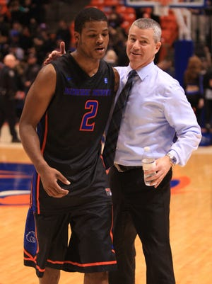 Boise State Broncos head coach Leon Rice and guard Derrick Marks (2) walk off the floor after Boise State defeated Colorado State 82-78 at Taco Bell Arena.