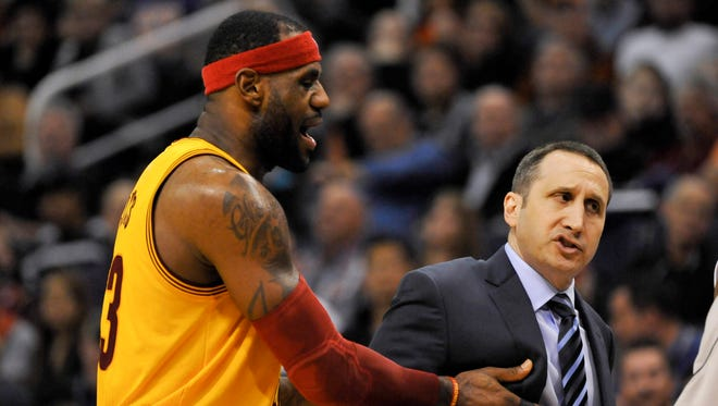 Jan 13, 2015; Phoenix, AZ, USA; Cleveland Cavaliers forward LeBron James (23) holds back Cavaliers head coach David Blatt as he reacts to a call during the second quarter against the Phoenix Suns at US Airways Center. Phoenix won 107-100. Mandatory Credit: Casey Sapio-USA TODAY Sports