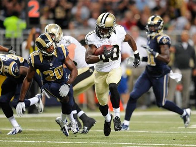 New Orleans Saints wide receiver Brandin Cooks (10) gets past St. Louis Rams cornerback Lamarcus Joyner (20) as Cooks scores a touchdown on a 25-yard pass reception in the third quarter of a preseason NFL football game Friday, Aug. 8, 2014, in St. Louis. (AP Photo/L.G. Patterson)