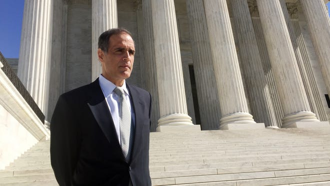 Florida resident Fane Lozman stands outside the Supreme Court Tuesday after attending the oral argument in his free speech case against the city of Riviera Beach.