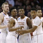 From left, Texas' Connor Lammert, Isaiah Taylor, Kerwin Roach Jr., Demarcus Holland and Eric Davis Jr., look to the bench against Northern Iowa on March 18, 2016, in Oklahoma City.