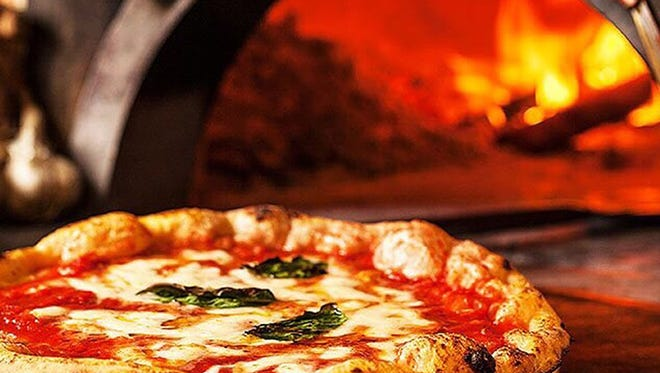 MidiCi Neapolitan Pizza cooks in Italian imported, wood-burning ovens, featuring temperatures up to 1,000 degrees that cook a pizza in as little as 90 seconds.