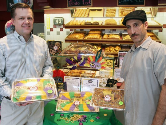 In honor of Mardi Gras festivities this month, a new line of King Cakes is now available through La Bonbonniere Bake Shoppes (via a partnership with legendary bakery Paul's Pastry Shop in Mississippi). The Edison-based bakery, with several Central Jersey locations, is making, shipping and selling the unique circular cakes. Here Bonbonniere owner Brian Pansari (left) and production manager Bobby Gomez (right) hold a couple of finished cakes that are for sale in the store.