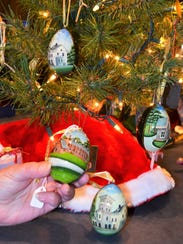Ornaments hand painted by craftsmen in Russia include