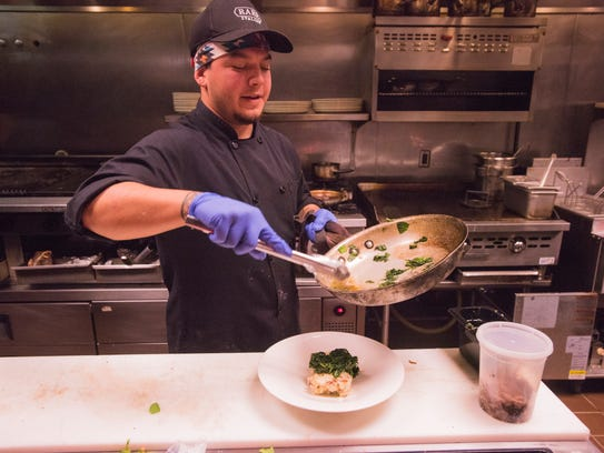 A chef works during a past Great Plates event.