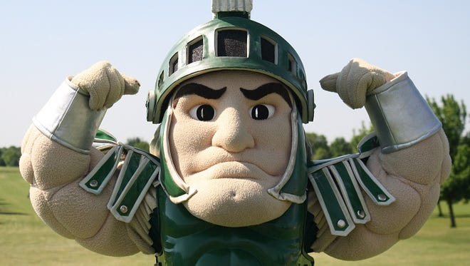 Michigan State is flexing enough muscle to convince oddsmakers it is the favorite to win the national championship ... this week.