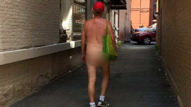 A naked man who declined to identify himself was spotted making several loops around downtown Burlington on Thursday, July 5, 2018. After a Free Press journalist asked to take his picture he ducked down the alley on the 190 block of College Street. Editor's note: The man's behind has been blurred.