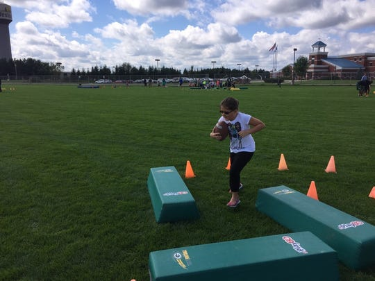 Ava Schueller completes one of the running back stations.