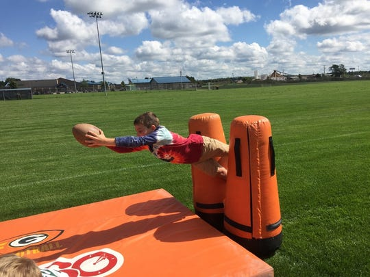 Ben Soehl jumps for a touchdown during the Green Bay Packers Outreach Camp at Mountain Bay Elementary School.