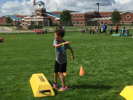 Isaak Beitzel throws the ball at the quarterback station.