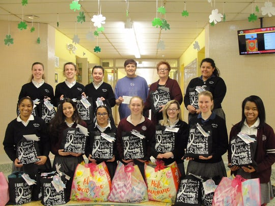 Chemo Care Bags collected by MotherSeton Regional High School students with the Cancer Center representatives.