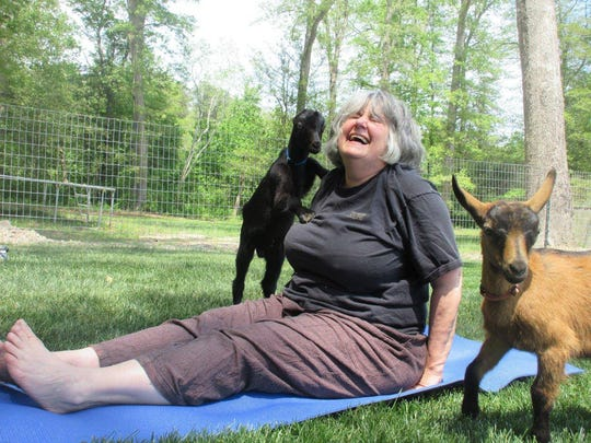 Judy Kirpich's face says it all during a yoga session at Goat Joy in Harbeson.