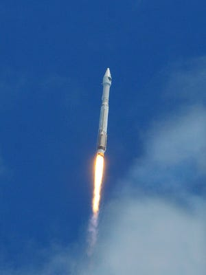 A United Launch Alliance Atlas V rocket carrying the Air Force's 10th Block IIF-10 navigation satellite lights up the sky July 15, 2015, over Cape Canaveral Air Force Station, Fla.