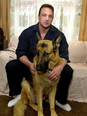 Nick Tartaglione is shown in 2001 in his then-Yonkers home with his former K-9 partner from the Pawling Police Department, now his pet, named Angus.