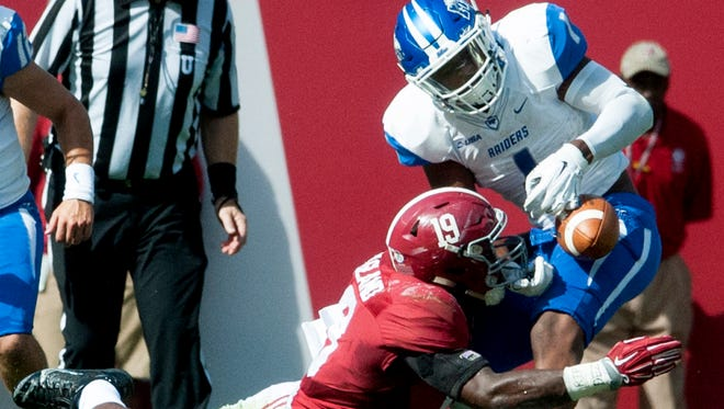 Alabama linebacker Reggie Ragland (19) causes a fumble by Middle Tennessee's Shane Tucker (1) during the first half Saturday in Tuscaloosa, Ala. The Blue Raiders committed four turnovers in the game.