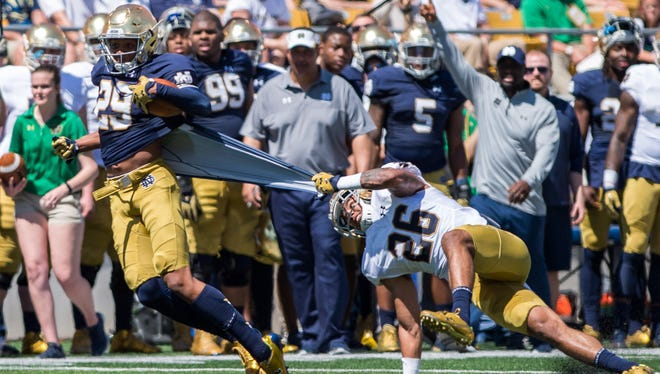 Apr 16, 2016; South Bend, IN, USA; Notre Dame Fighting Irish safety Ashton White (26) grabs onto the jersey of wide receiver Kevin Stepherson (29) in the second quarter of the Blue-Gold Game at Notre Dame Stadium. The Blue team defeated the Gold team 17-7. Mandatory Credit: Matt Cashore-USA TODAY Sports