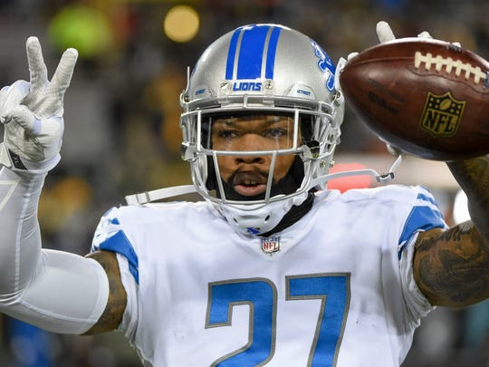 Lions safety Glover Quin warms up prior to the game