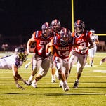 Teurlings Catholic running back Jansen Lormand (14) slips away from St. Thomas More's Hunter Markerson (3) on a run before scoring a touchdown during an LHSAA football game at Teurlings Catholic High School in Lafayette, La., Friday, Oct. 23, 2015.