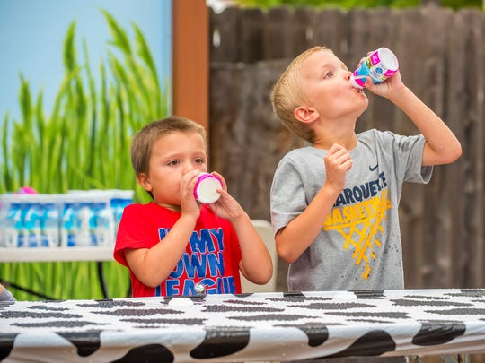 Milk chugging is one of the fun activities at the Milwaukee County Zoo's Family Farm Weekend.