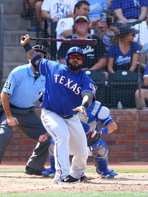 Texas Rangers first baseman Prince Fielder bats against the Kansas City Royals during a Spring Training game at Surprise Stadium.