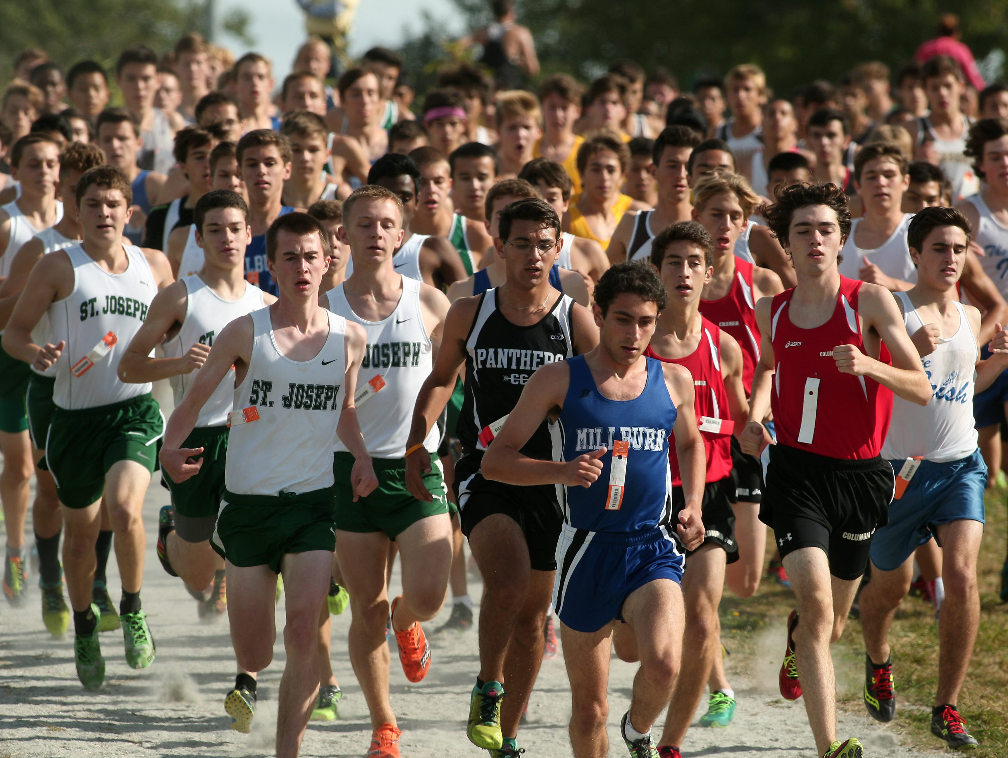 The start of the Varsity boys A 5K run of the Stewart Memorial Invitational at Central Park of Morris County. September 26, 2015, Morris Plains, NJ.