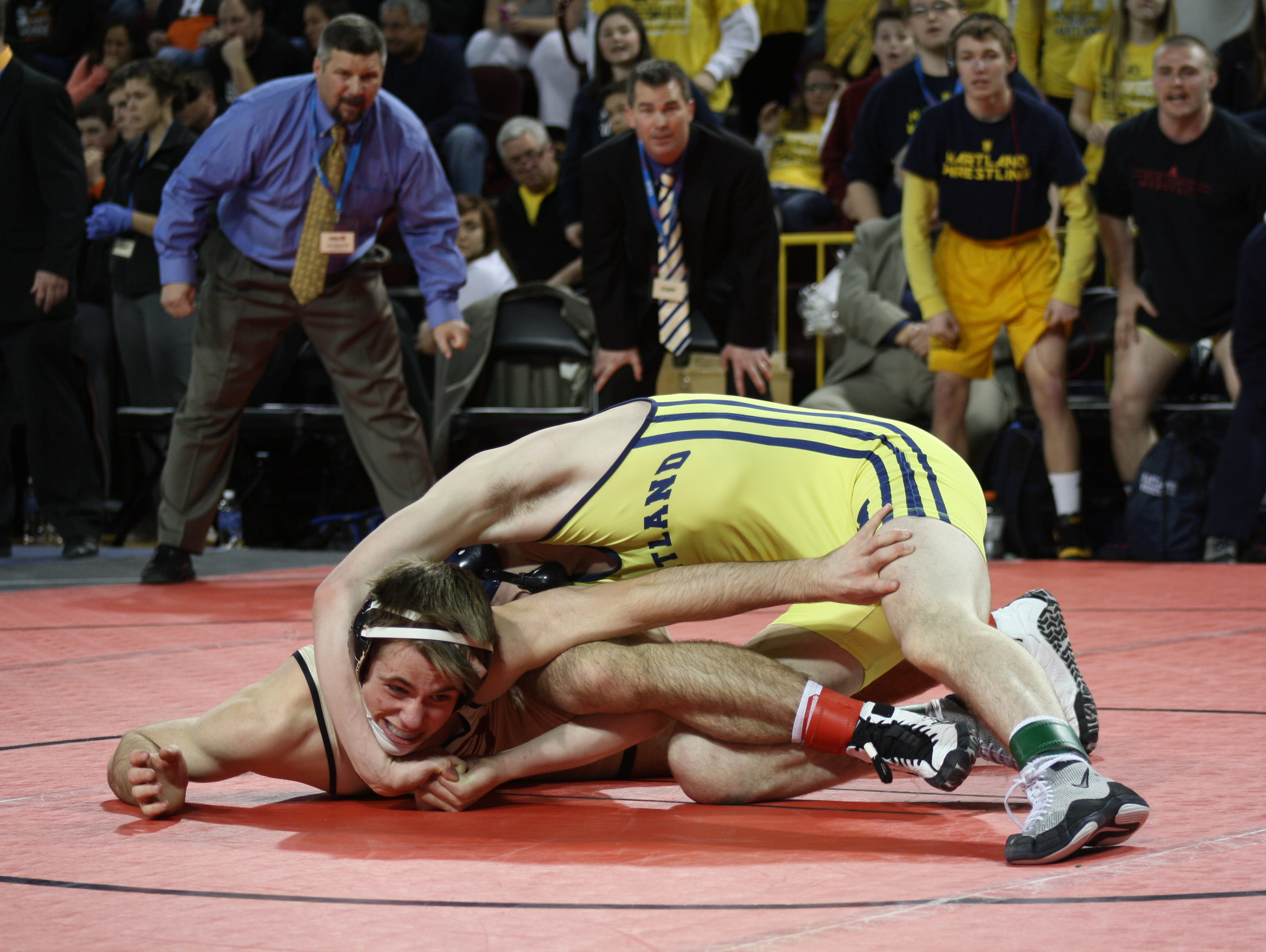 Hartland's Nick DiNobile, top, wrestles Davison's Brian Case. Case won the Div. 1 match, 9-3, at 135 pounds.