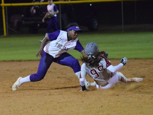 ASH's Taryn Seal (1, left) tags Pineville's Kacee Mertens (99, right) out at second after Mertens tried to steal second.