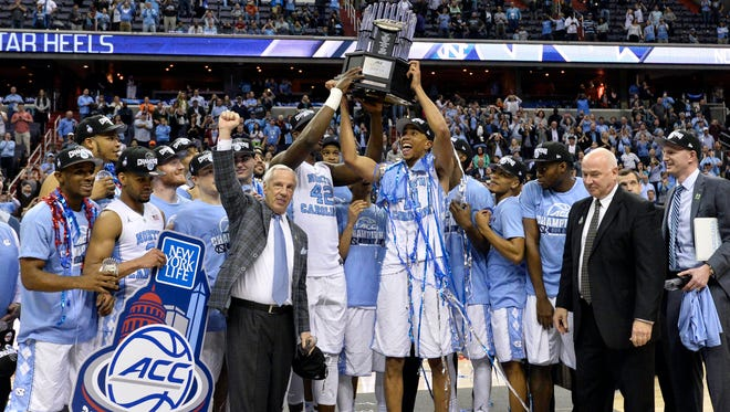 North Carolina celebrate after defeating Virginia in the championship game of the ACC conference tournament.