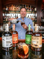 Ballotin Whiskey distiller Paul Tuell with a Ballotin Chocolate Whiskey arrangement at Jack's Lounge, July 14, 2016.