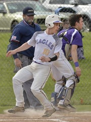 Scoring another run for Plymouth Christian Tuesday is Matt Cusumano (No. 10).