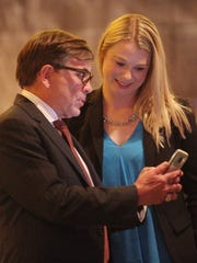 Palm Springs City Mayor, Robert Moon shares a moment with Palm Springs city council candidate Christy Holstege November 7, 2017 at the Hard Rock Hotel.